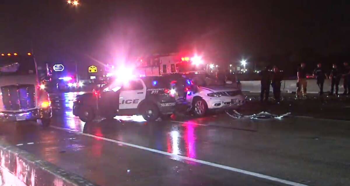 Two police officers were hospitalized May 23, 2021, after being hit by two separate vehicles while blocking traffic to an earlier crash.