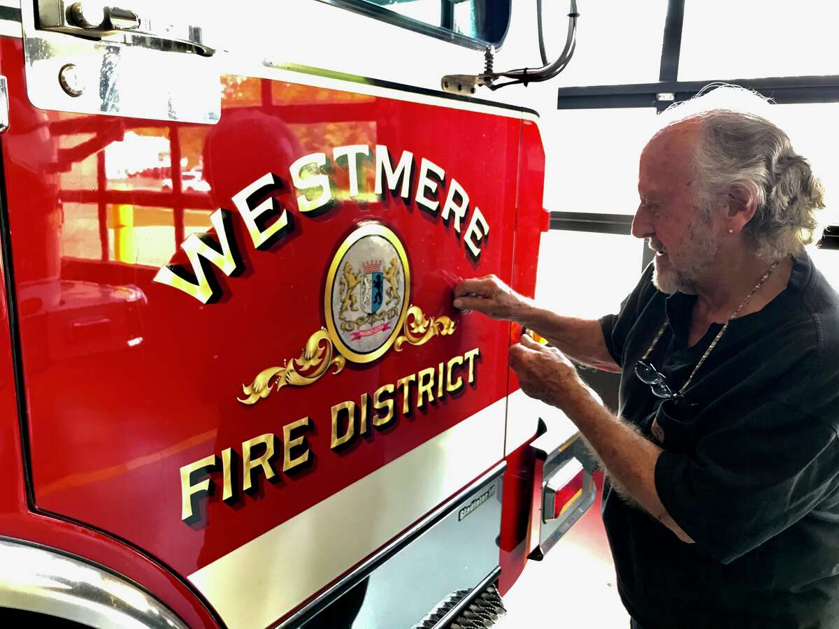 Robert Francis Whelan, 86, has painted gold leaf on more than 640 fire trucks since 1959 including this one at Westmere Fire Department.