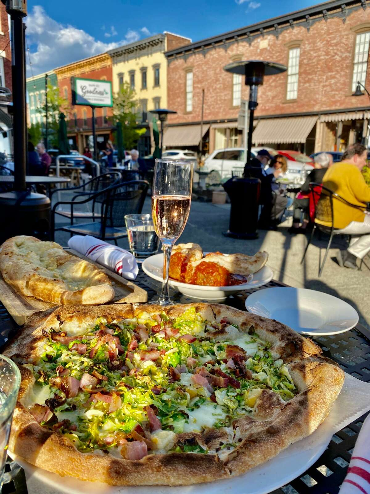 Expansive sidewalks seating and awninged shops and restaurants give downt0wn Chatham a European feel. One of the pizzas at Nonne Pizza & Cucina has prosciutto and shaved Brussels sprouts.