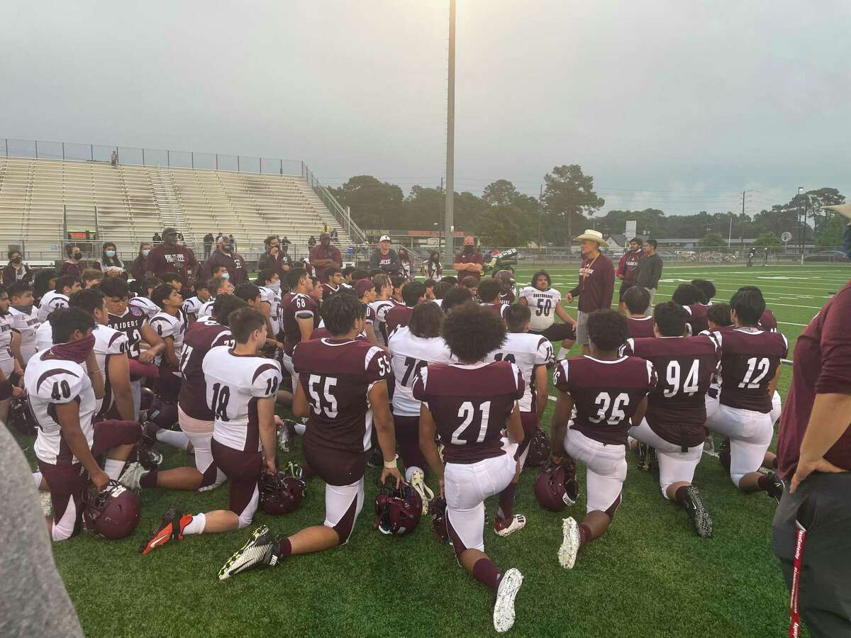 Coach Andres Gomez talks to the Northbrook football team following its Spring Game on May 19 at Spring Woods High School. A turf field was installed at Spring Woods High School last year as part of the 2017 Spring Branch ISD school bond.