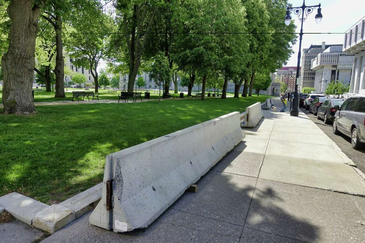 The barricades that were blocking State St. near the Capitol have been removed from the street and have been placed on the sidewalk seen here on Monday, May 24, 2021, in Albany, N.Y. Vehicle traffic is now allowed along this section of State St. (Paul Buckowski/Times Union)