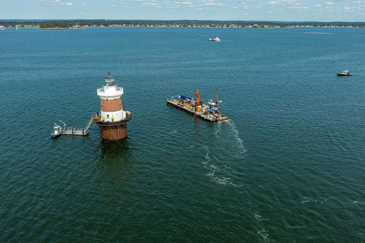 Peck Ledge Lighthouse undergoes restoration work in September 2020. The Norwalk lighthouse is privately owned and being restored after damage from Superstorm Sandy.