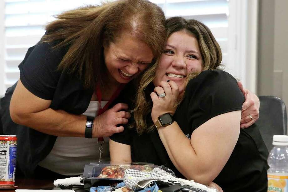 Employees Janet Lozano, left, and Clarissa Ponce rejoice in winning the Aspen Prize. SAC boasts above-average graduation and transfer rates. Photo: Jerry Lara/Staff Photographer / **MANDATORY CREDIT FOR PHOTOG AND SAN ANTONIO EXPRESS-NEWS/NO SALES/MAGS OUT/TV   © 2019 San Antonio Express-News