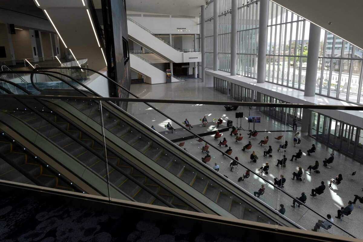 People gather for a panel discussion for Global Meetings Day at the newest addition to the Las Vegas Convention Center in Las Vegas, Nevada on April 8, 2021.