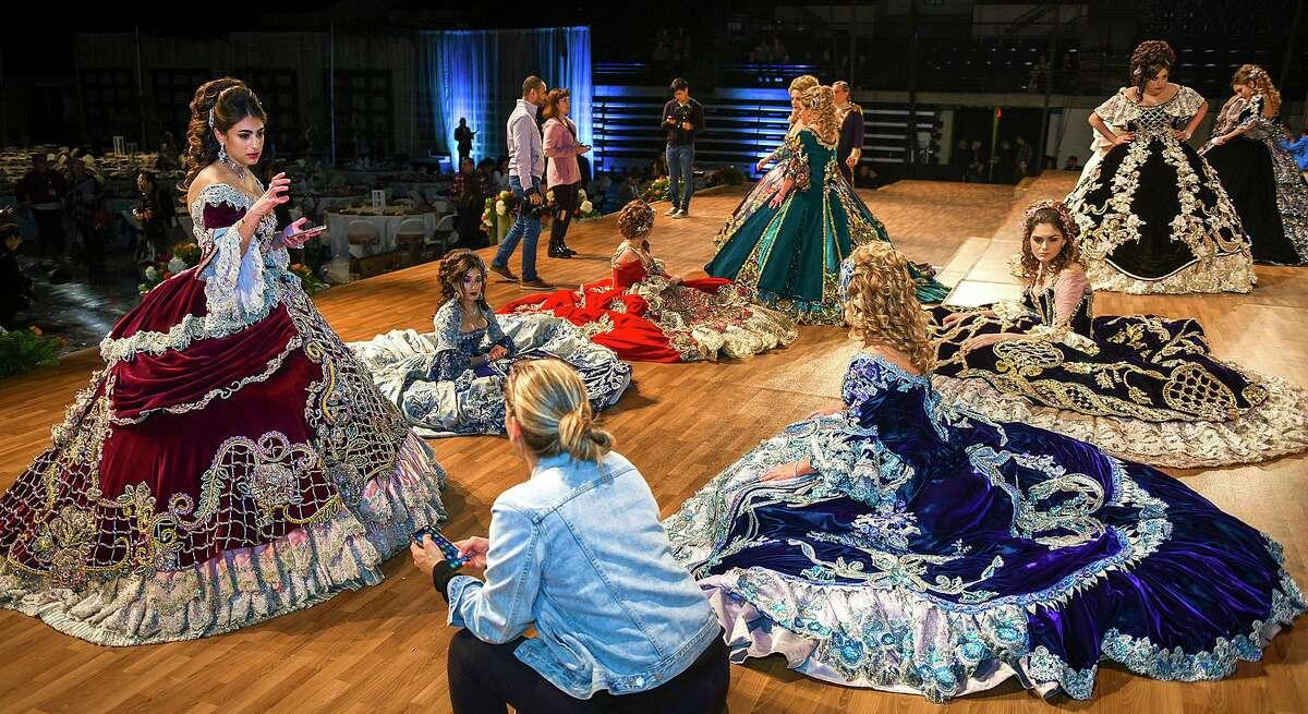 Society of Martha Washington debutantes and their escorts get ready for a dress rehearsal, Thursday, Feb. 20, 2020, at the Sames Auto Arena.