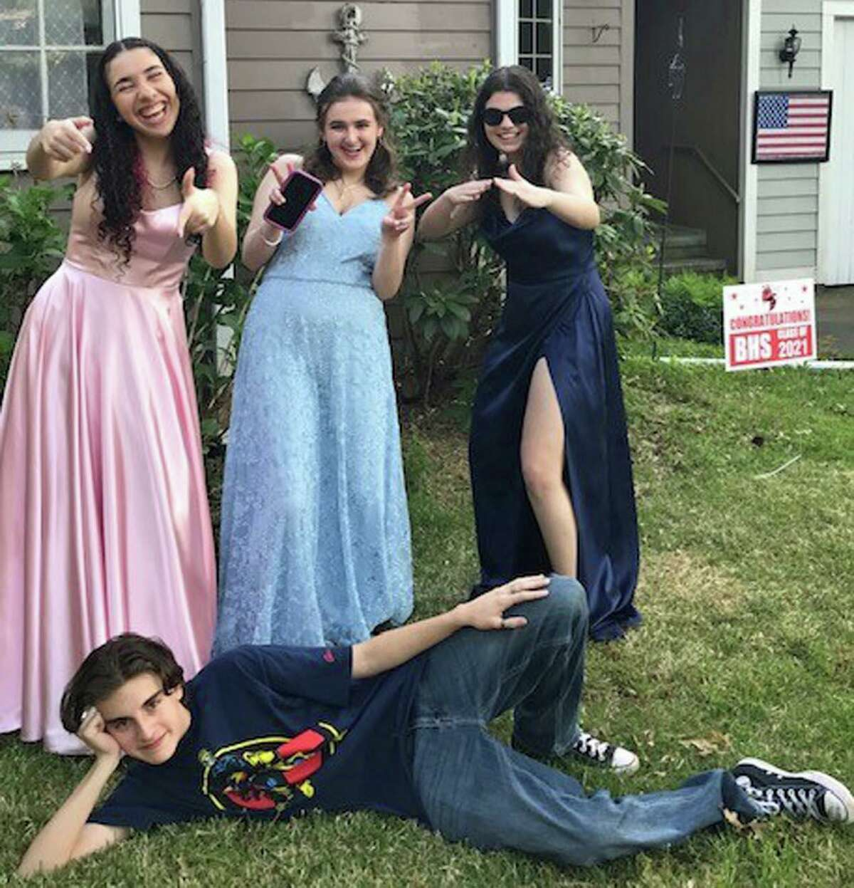 The writer's daughter's prom last weekend. Stella Penn is far left and his son Luke is on the ground, mugging for the shot.