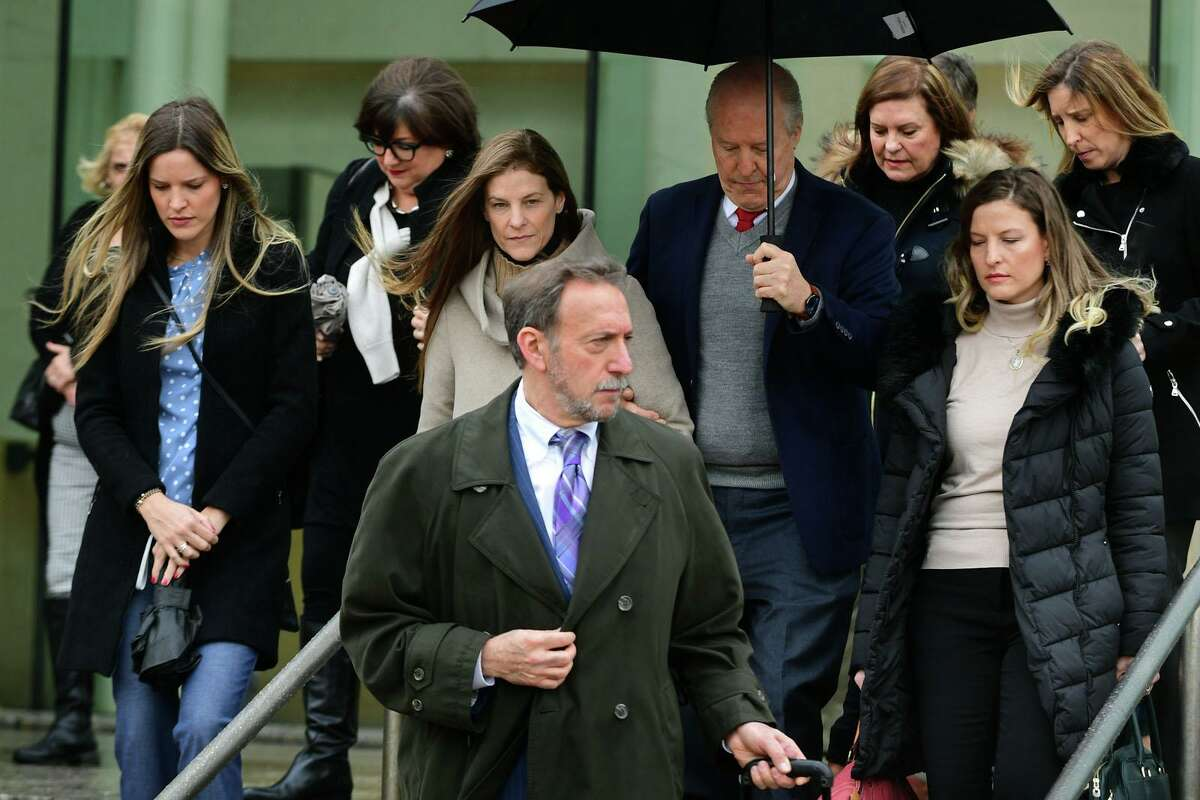 Michelle Troconis, charged with conspiracy to commit murder in the disappearance of Jennifer Dulos, exits the court following a pretrial hearing with her family and attorney Jon L. Schoenhorn Friday, February 6, 2020, at the Stamford Superior Court in Stamford, Conn.