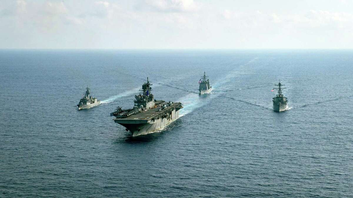 FILE -- A photo provided by the U.S. Navy shows American and Australian warships last year in the South China Sea on April 18, 2020. A growing global competition with China and Russia looms over a gathering of foreign ministers in London. (Nicholas Huynh/U.S. Navy via The New York Times)