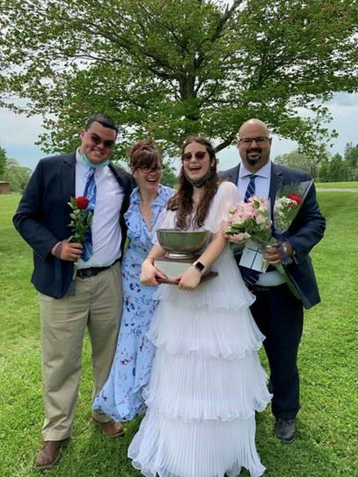 Co-Valendicatorian and Wittenberg Cup recipient Olivia Pignataro with her brother Nick '18 and their parents, Elizabeth and Carl Pignataro. Pignatoro was among 27 Marvelwood School students to graduate in an outdoor ceremony on Saturday, May 22, 2021 in Kent, Conn.