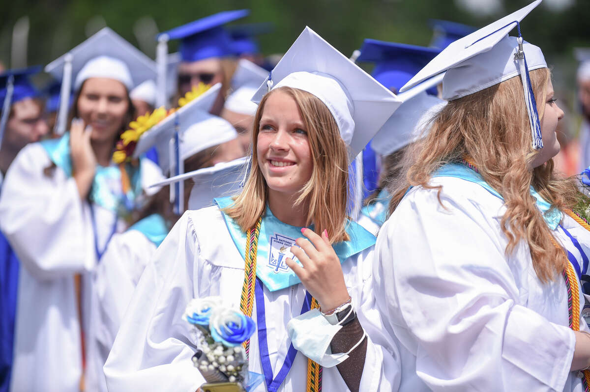 The Coleman High School Class of 2021 celebrate during a commencement ceremony Sunday, May 23, 2021 at the school in Coleman. (Adam Ferman/for the Daily News)