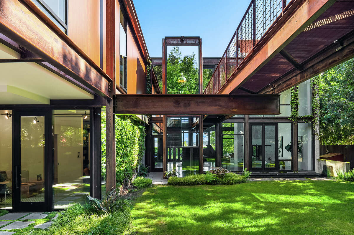 Kundig's love of angles is never overly industrial because his use of glass creates a mirror-like effect with the surrounding greenery.