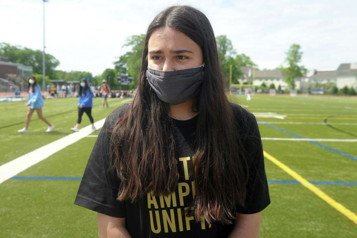 Senior Sophia Mughal speaks during an interview following a student walk out she helped organized at Fairfield Ludlowe High School, in Fairfield, Conn. May 24, 2021. Students at Ludlowe and across town at Fairfield Warde High School held walk outs Monday morning to protest recent racist incidents.