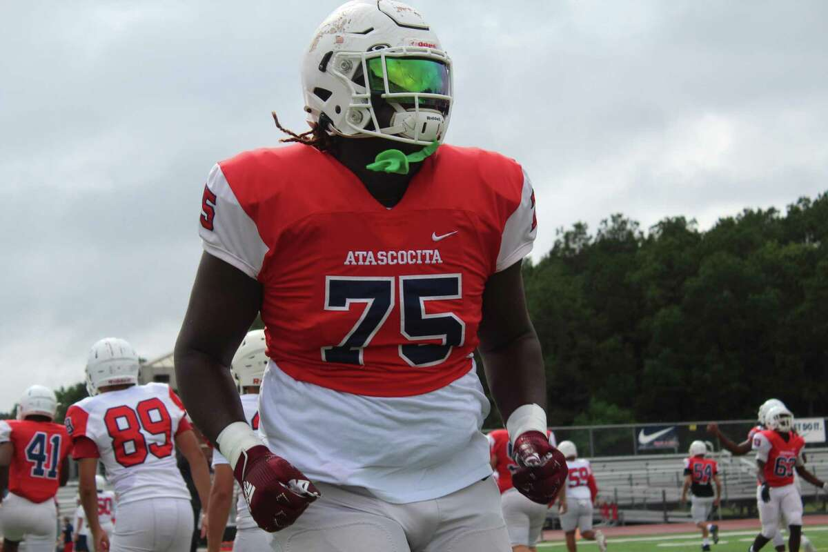 Atascocita offensive lineman Kam Dewberry streching before the Eagles' spring game.