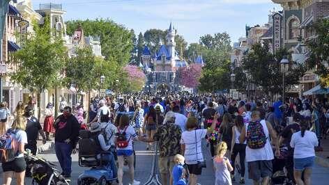 Crowds fill Disneyland's Main Street U.S.A. on opening day, April 30.
