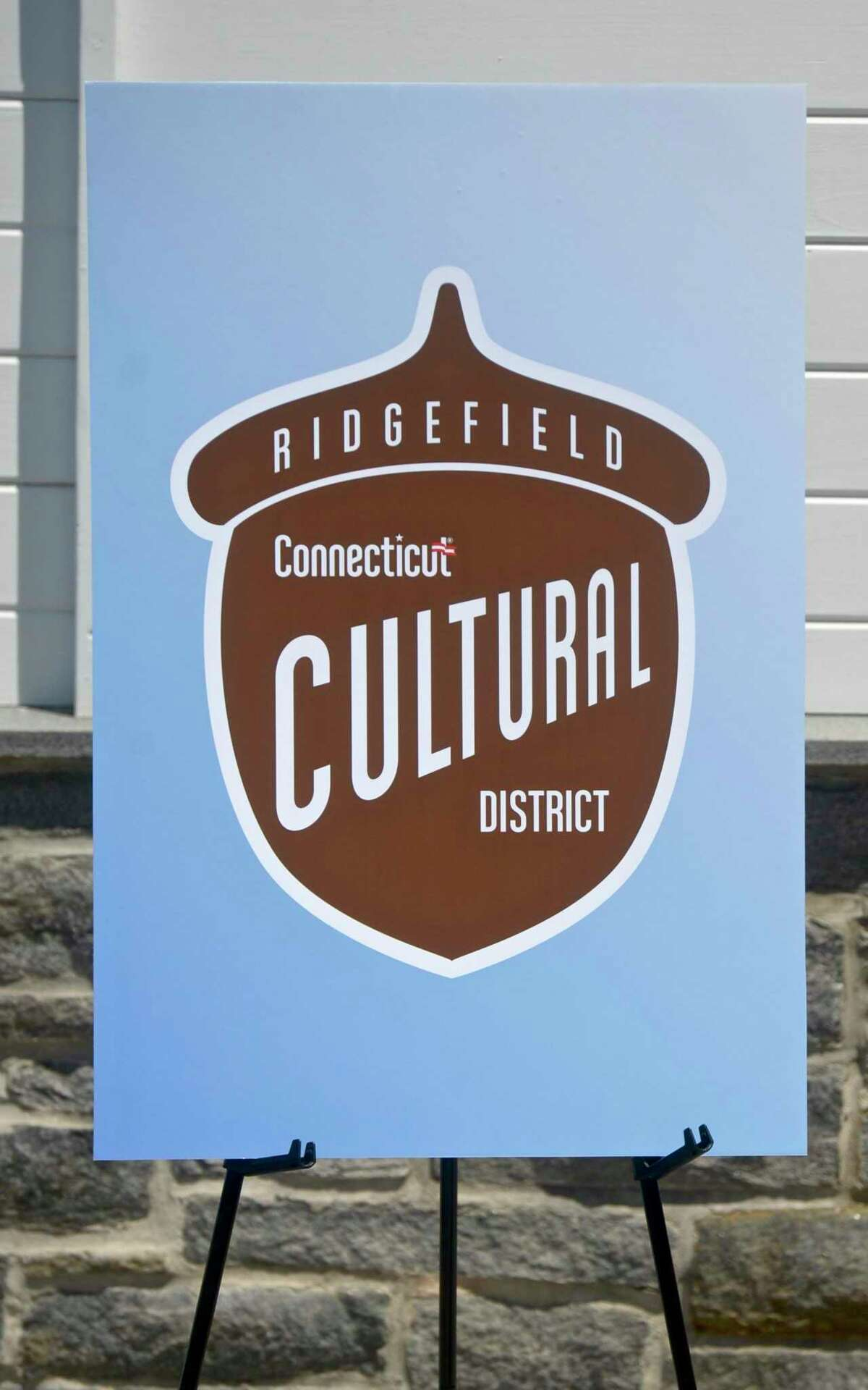 Ridgefield's Economic and Community Development Commission Chairman Geoffrey Morris unveiled the logo for the district's signage, which includes a picture of an acorn - a nod to the Charter Oak Cultural Center in Hartford.