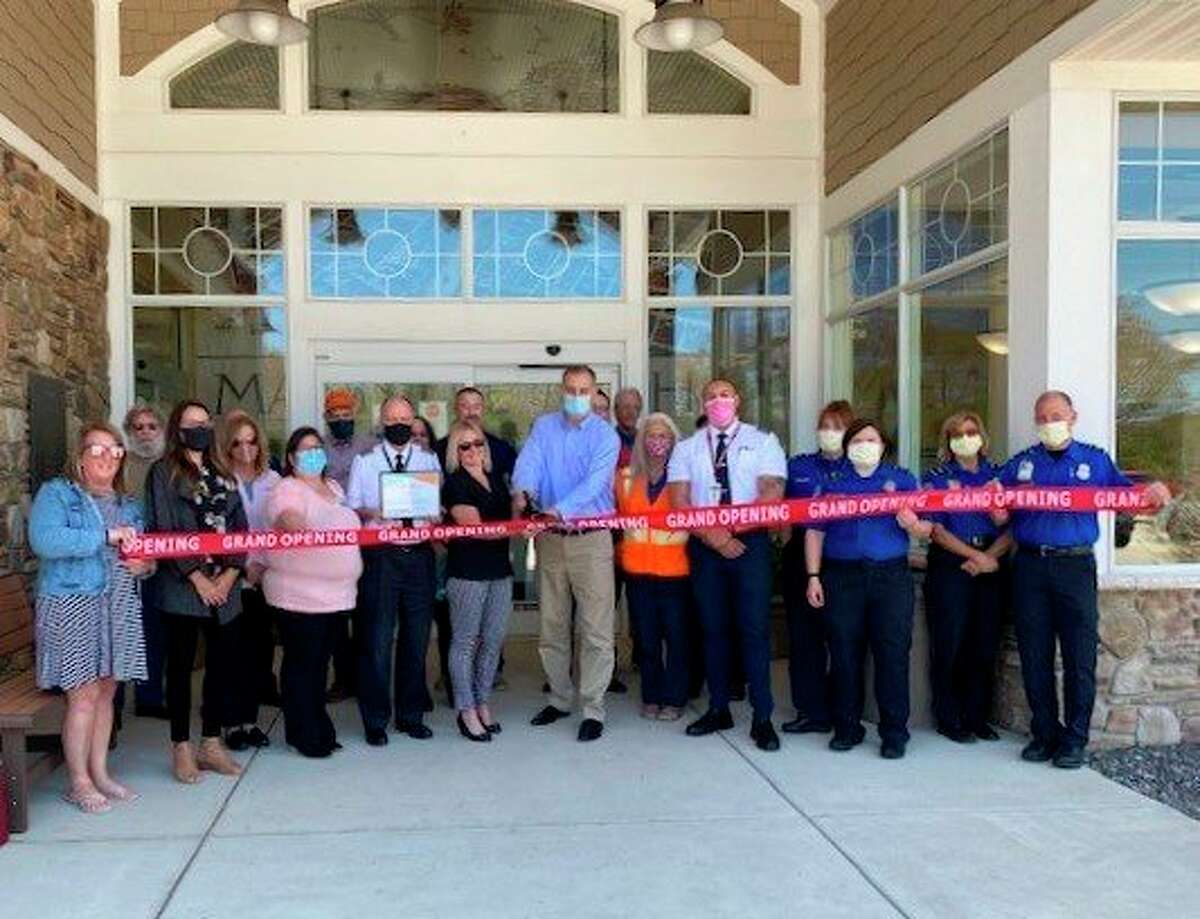 A ribbon-cutting ceremony was held at the Manistee County Blacker Airporton May 17 to celebrate Cape Air increasing thenumber of flights between Manistee County Blacker Airport and Chicago O'Hare International Airport from two daily, round-trip flights to four daily, round trips due to the seasonality tourism in northern Michigan. (Courtesy photo)