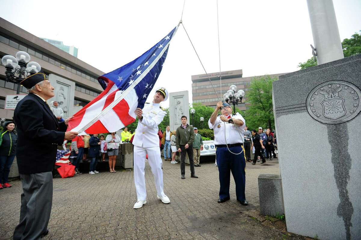 The American flag gets raised during a ceremony in Veteran's Park following the annual Memorial Day parade in downtown Stamford, Conn. on Sunday, May 27, 2018.