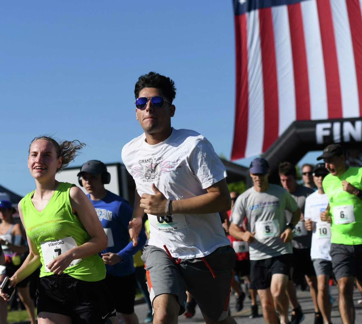 Photos from the first Memorial Day 5K run at Cummings Point Park in Stamford, Conn. Monday, May 27, 2019. Due to diminishing crowds and ongoing renovation of Veterans Memorial Park, Stamford held a 5K run and Memorial Day ceremony instead of the usual parade through downtown. About 300 runners participated in the 5K, which preceeded a service on the beach in honor of the fallen veterans.