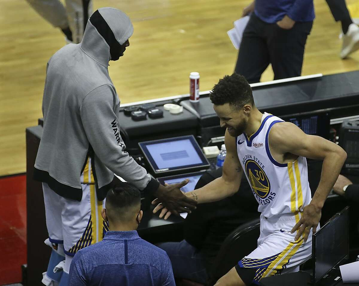 Golden State Warriors guard Stephen Curry (30) leaves the court with injury after the third quarter of the NBA game against the Houston Rockets Wednesday, March 17, 2021, at Toyota Center in Houston.
