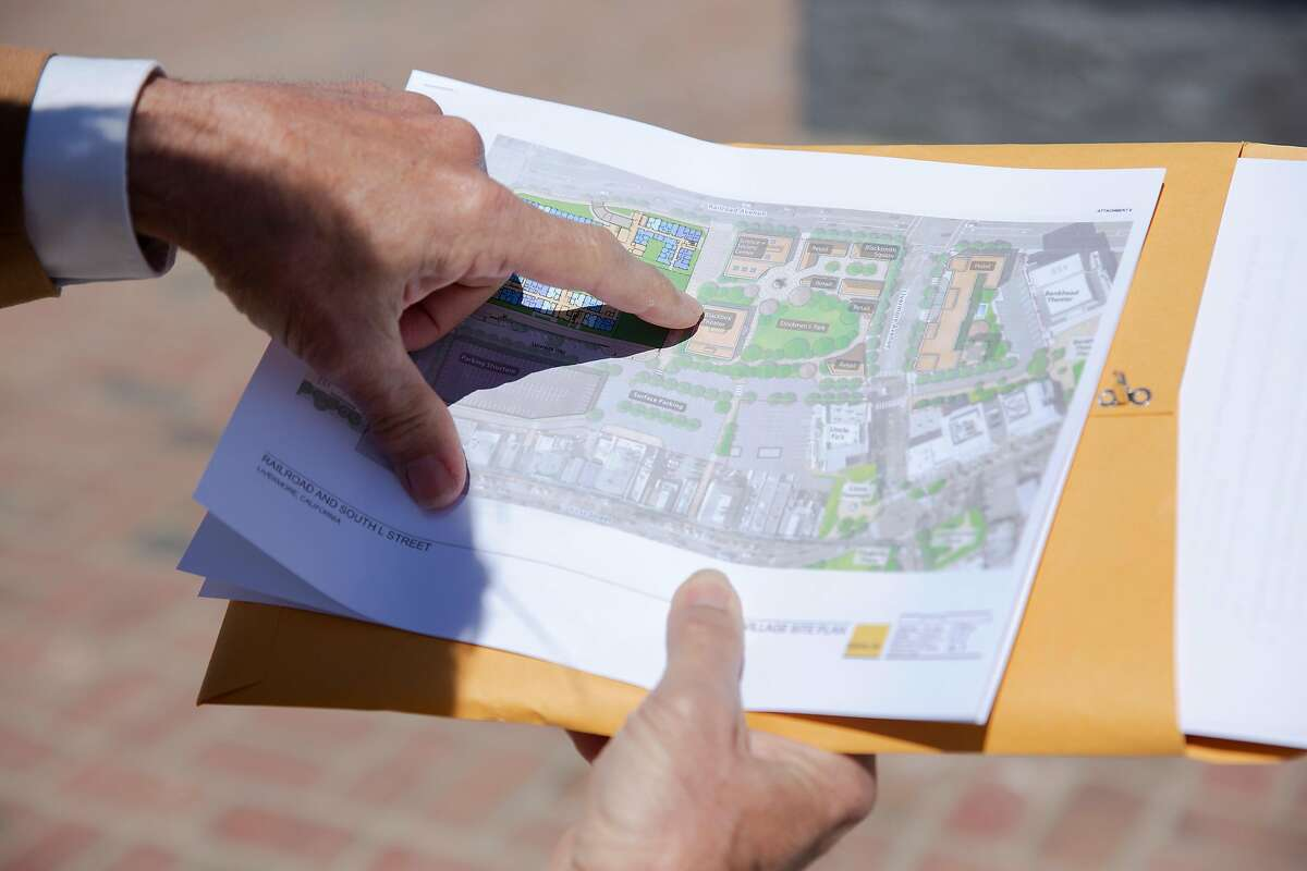 John Marchand, a former mayor of Livermore, points out different places on a plan for 130 units of new affordable housing that is planned to be built in conjunction with Stockmen's Park in Livermore, Calif. on Wednesday, May 19, 2021.