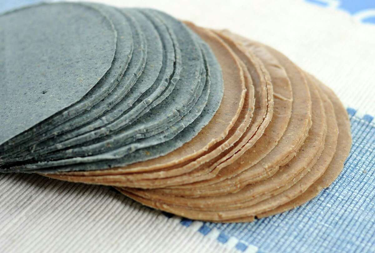 Blue corn, left, and pink corn tortillas from Ancient Heirloom Grains