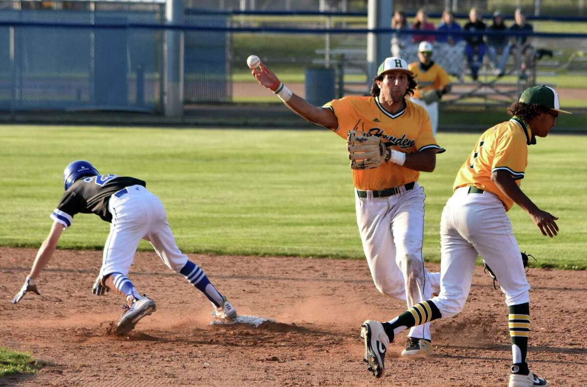 Hamden's Jake Pisano tries to complete the double play against West Haven in May.