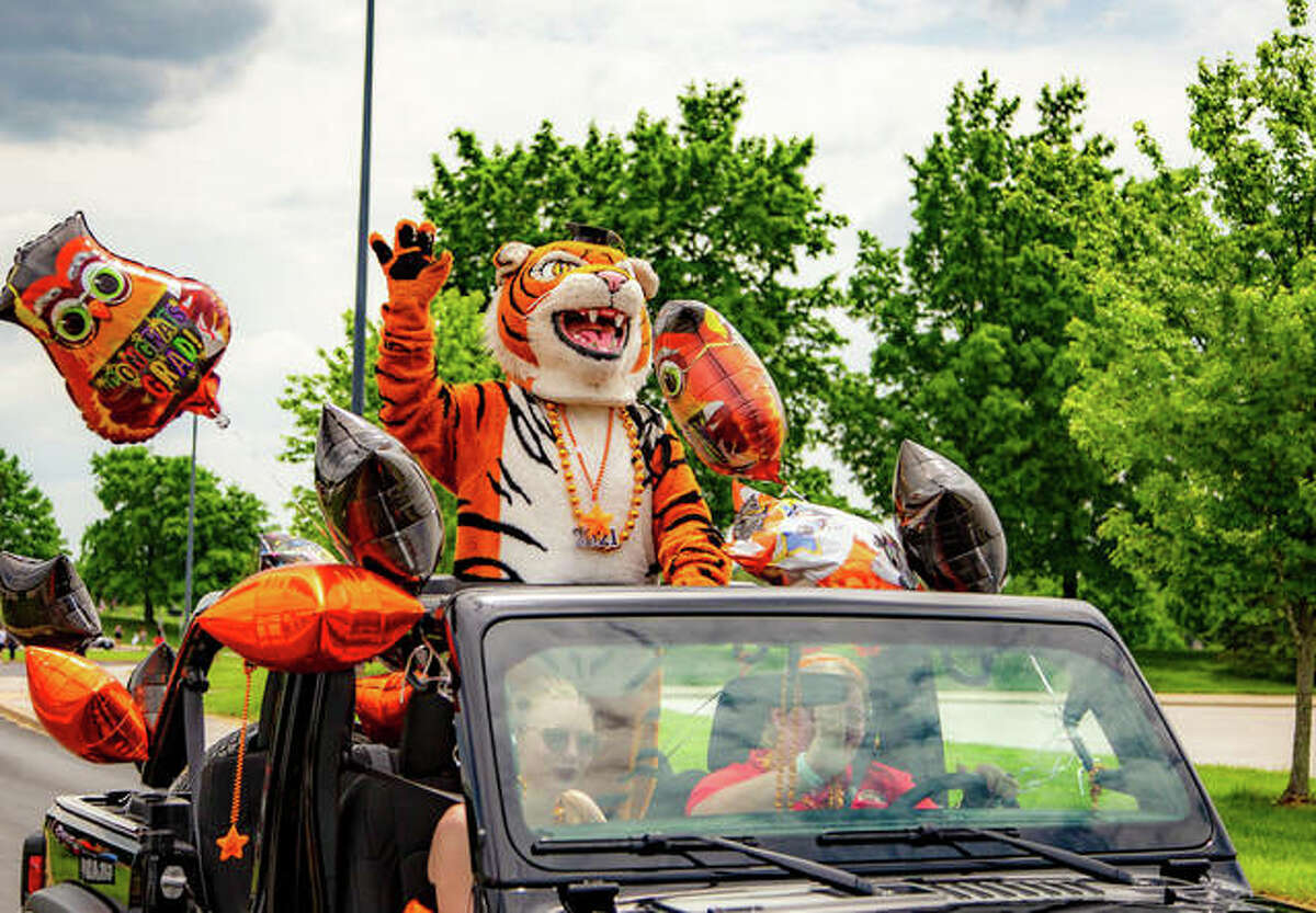 The Edwardsville High School mascot shows off the school colors orange and black, and school spirit during the