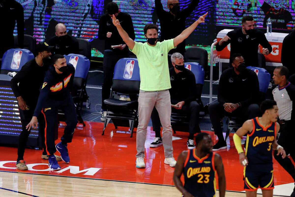 Golden State Warriors' Klay Thompson reacts to a Jordan Poole 3-pointer against Memphis Grizzlies during 1st quarter of NBA Play-In Tournament game at Chase Center in San Francisco, Calif., on Friday, May 21, 2021.
