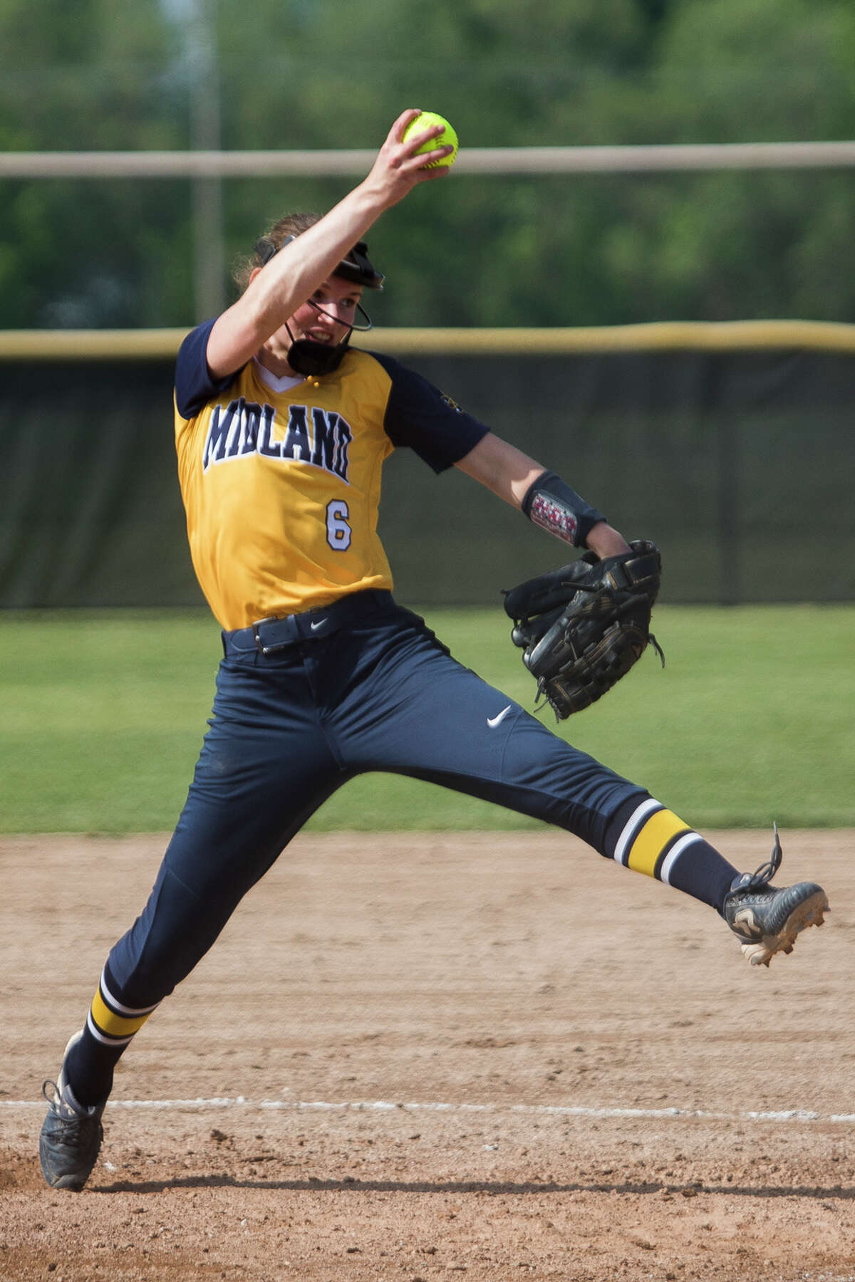 Midland's Rachel Mecca pitches the ball during a game against Bullock Creek Monday, May 24, 2021 at Bullock Creek High School. (Katy Kildee/kkildee@mdn.net)