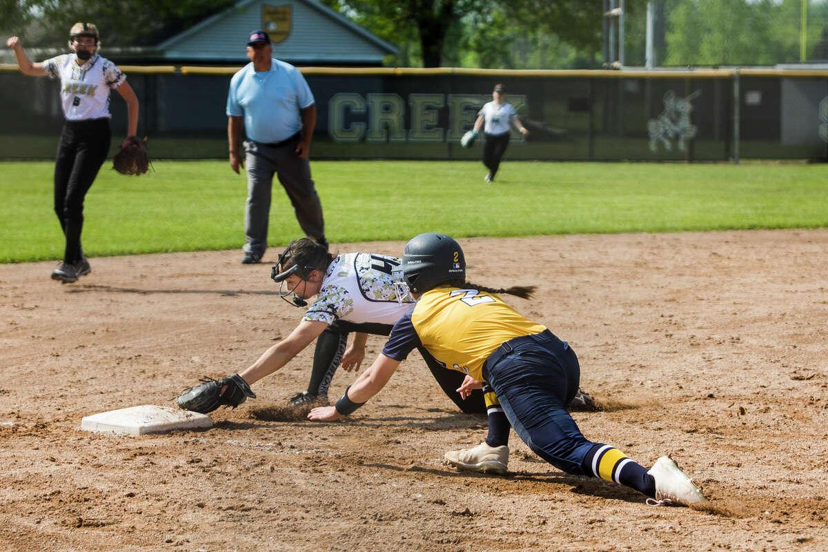 Bullock Creek's Olyviah Hanson tags out Midland's Kiara Kiely at third base during their game Monday, May 24, 2021 at Bullock Creek High School. (Katy Kildee/kkildee@mdn.net)