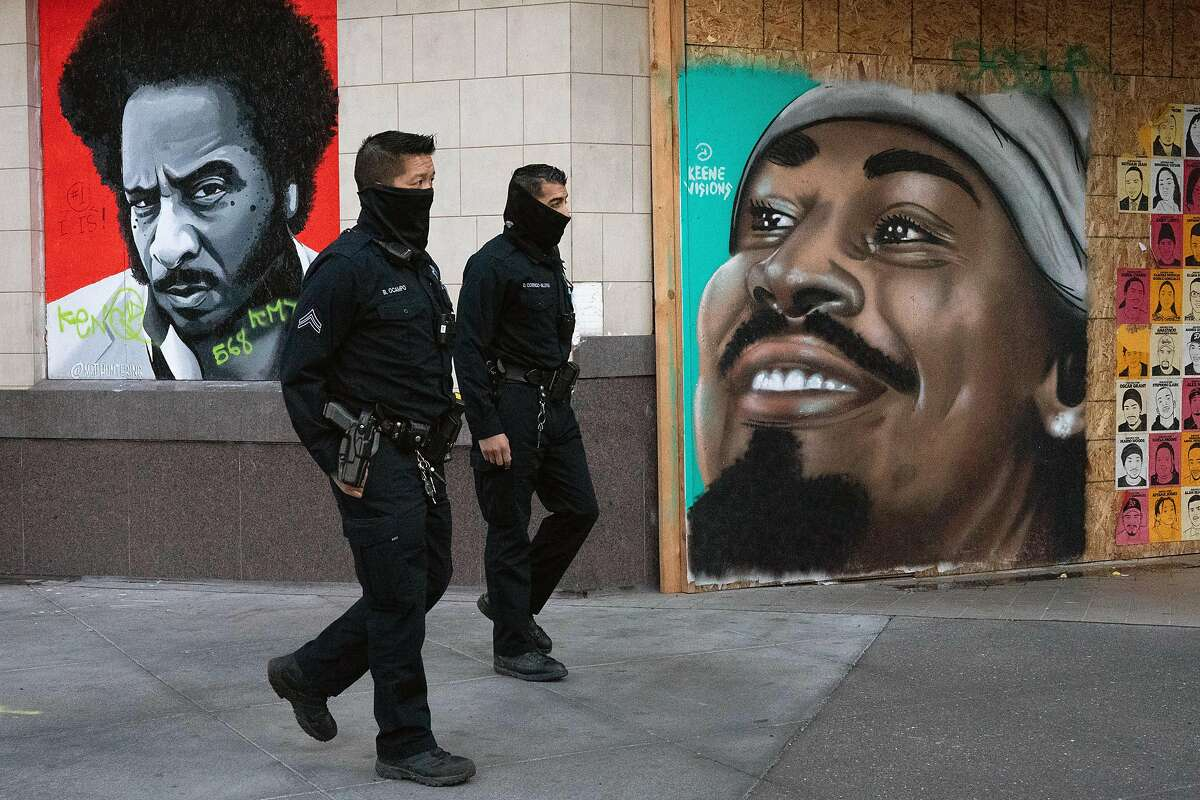 Oakland police officers Bryant Ocampo and Daniel Cornejo-Valdivia patrol downtown in December.