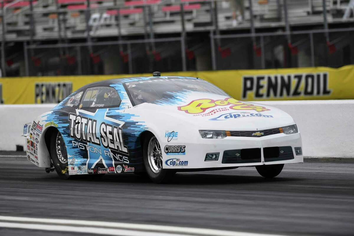 Pro Stock driver Matt Hartford coasts to his second victory at the Mopar Express Lane NHRA SpringNationals at Houston Raceway Park in Baytown, Texas, when he defeated Deric Kramer in the final round Monday, May 24, 2021. (Gary Nastase/Auto Imagery via AP)