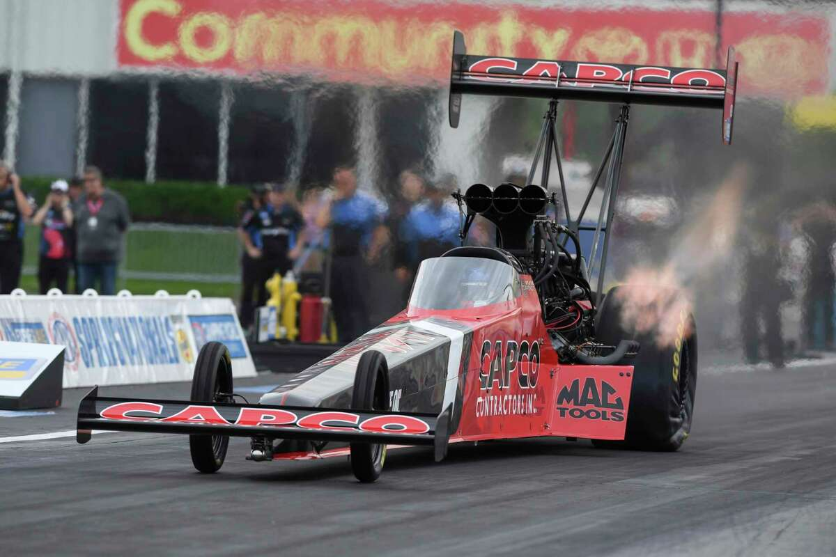 Texas native Steve Torrence pedals his Top Fuel dragster to secure his first win at Houston Raceway Park in Baytown, Texas, Monday, May 24, 2021, when he defeated Doug Kalitta in the final round of the Mopar Express Lane NHRA SpringNationals. (Jerry Foss/NHRA via AP)
