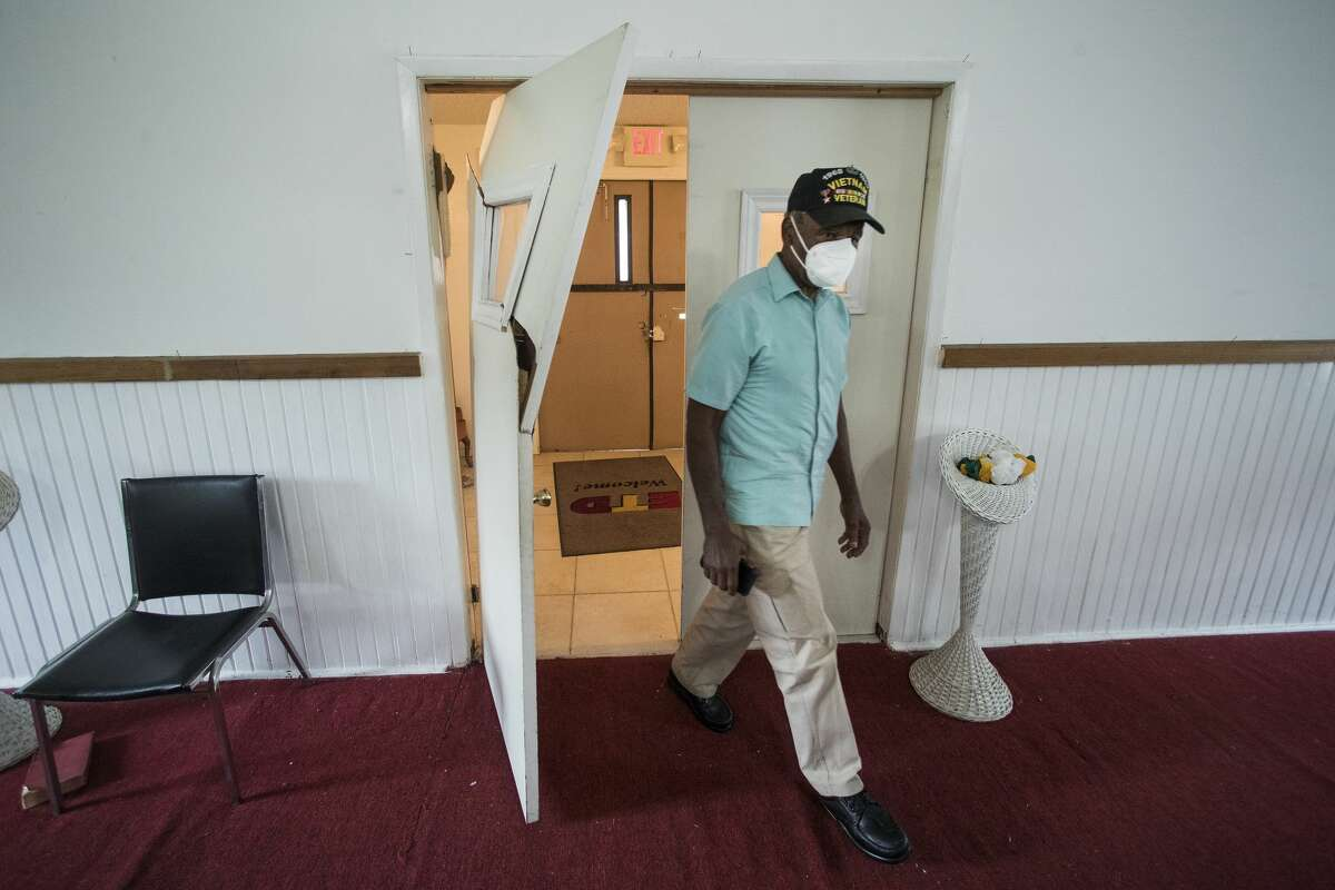 The Rev. Percy Moultry, senior pastor & presiding bishop of IME Organization, walks past a damaged door from a recent break in inside Anointed Christian Tabernacle of Saints Church in Independence Heights Monday, May 24, 2021 in Houston. At least three Independence Heights churches have been impacted by a rash of burglaries between late April and early May. The suspects made off with thousands of dollars worth of music equipment, appliances and piles of donated food and clothes. At one church, Hunter Memorial Church of God In Christ, vandals left walls covered in profanity-laced graffiti. At the nearby Anointed Christian Tabernacle of Saints, the suspects broke down doors and removed sink faucets and toilet flush valves.