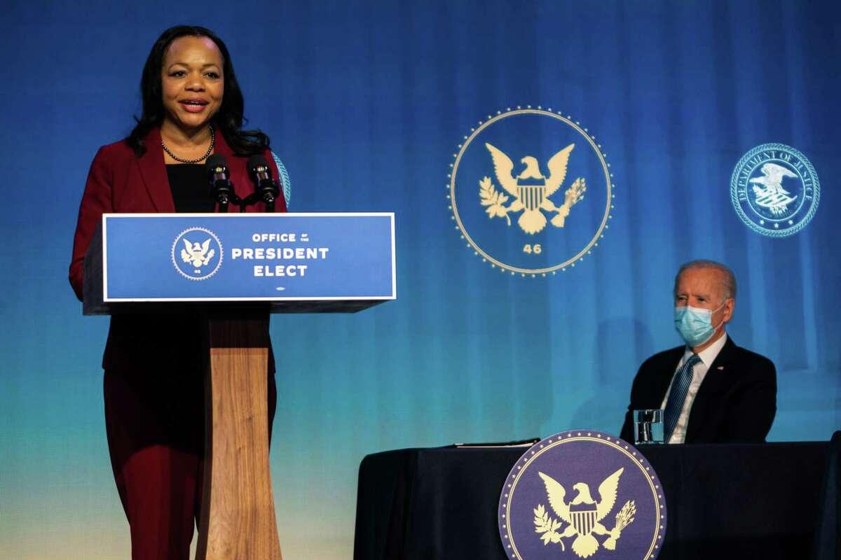 President-elect Joe Biden watches as Kristen Clarke speaks to reporters in Wilmington, Del., on Jan. 7.