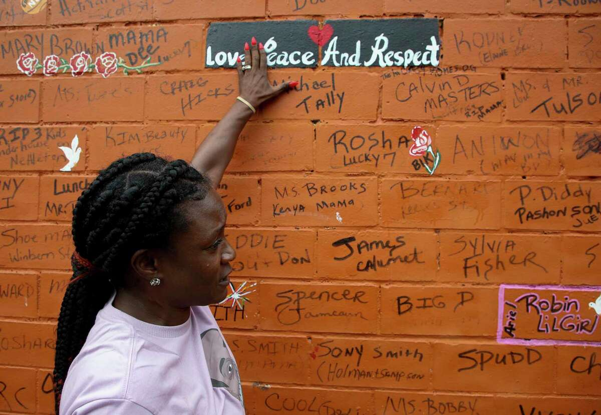 """Kim Hewitt talks about """"The Wall,"""" which stands as a stark reminder of the human toll recently suffered by the Third Ward community."""