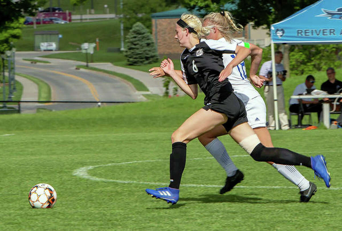 Kaya Theis of LCCC, a freshman from Marquette Catholic, races for the ball with an Iowa Western player Monday in Council Bluffs, Iowa. LCCC lost 3-1 in the Central District championship game and must await word on an at-large berth at the NJCAA National Tournament.