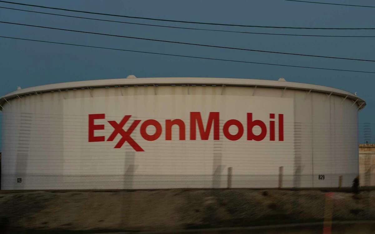 Exxon Mobil storage tank in Baytown. Exxon Mobil faces its biggest challenge yet from activist investors who have long pressured the U.S. oil giant to address more urgently the growing risk of climate change to its fossil fuels business
