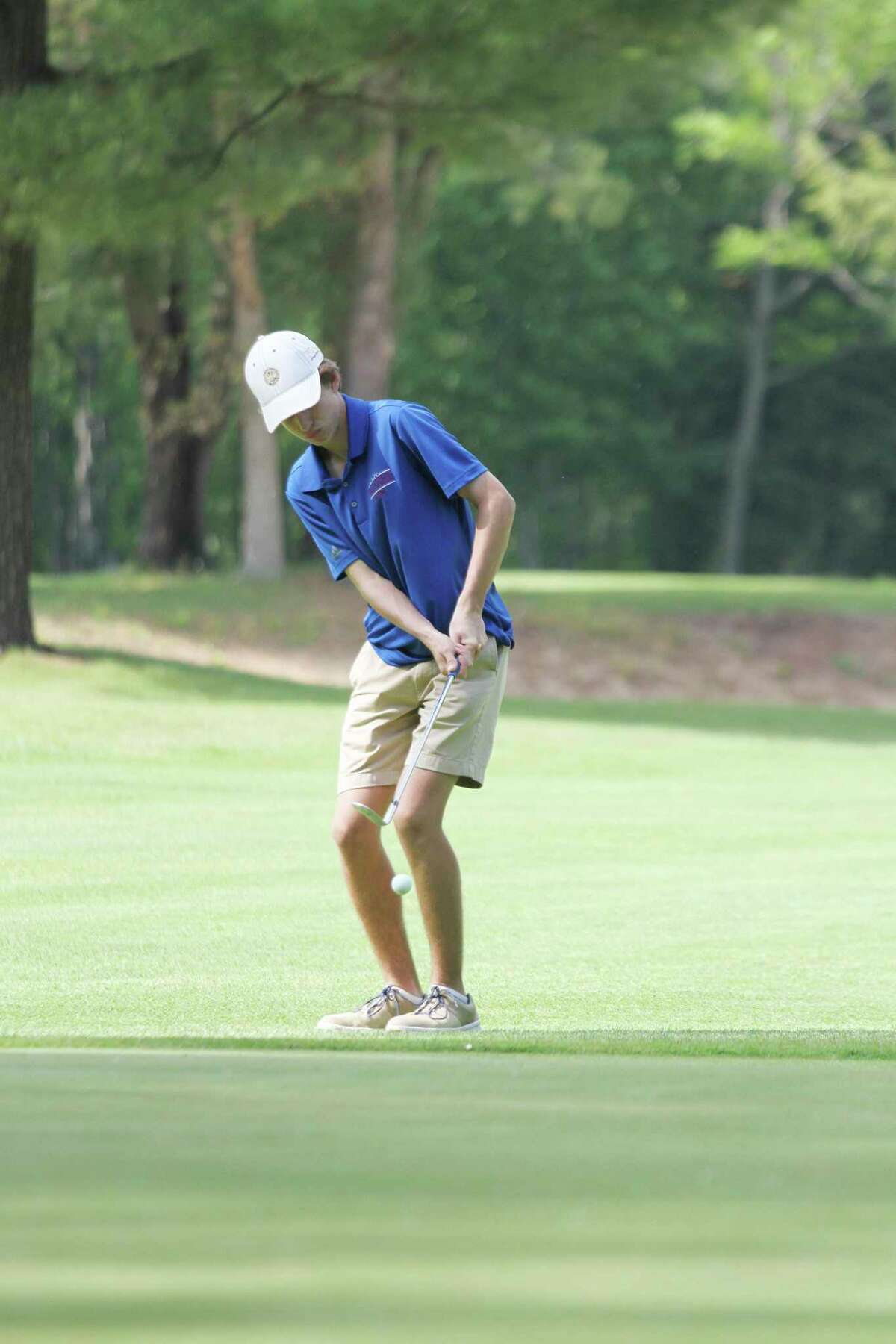 Manistee Catholic Central's Alex Shriver chips onto the green Monday at Manistee National Golf & Resort. (Dylan Savela/News Advocate)
