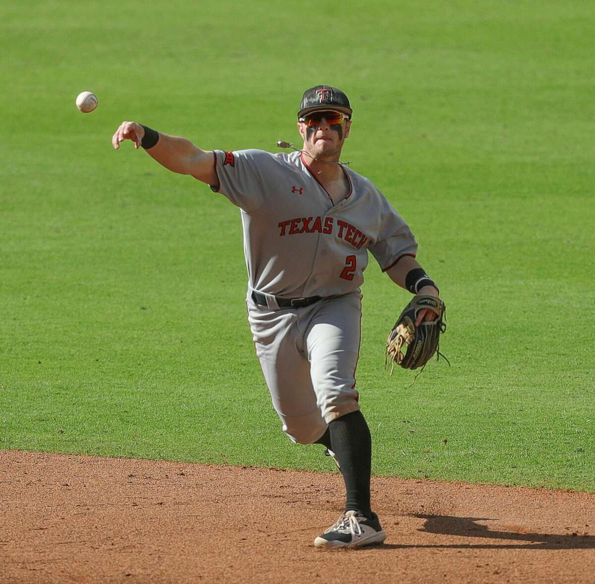 HOUSTON, TEXAS - MARCH 06: Jace Jung #2 of the Texas Tech Red Raiders throws to first base against the Sam Houston State Bearkats at Minute Maid Park on March 06, 2021 in Houston, Texas. (Photo by Bob Levey/Getty Images)