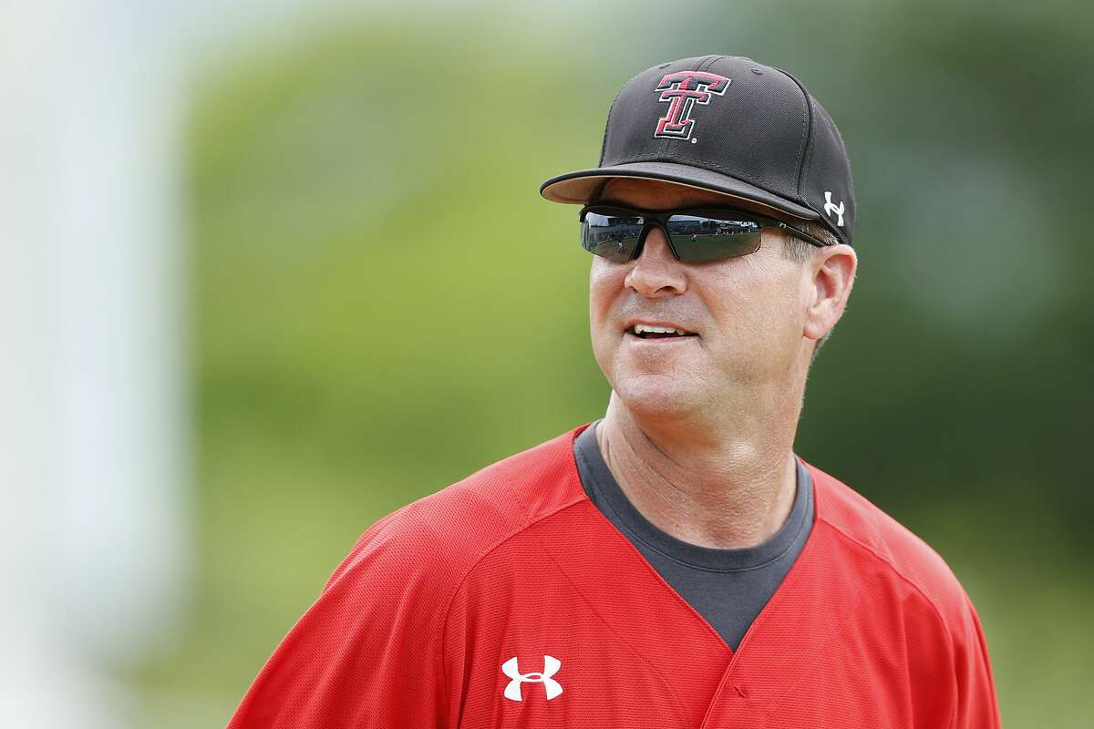 CORAL GABLES, FL - JUNE 2: Head coach Tim Tadlock #6 of the Texas Tech Red Raiders looks on as the players warm up prior to the game against the Miami Hurricanes in during the Coral Gables Regional at the NCAA Baseball Tournament on June 2, 2014 at Alex Rodriguez Park at Mark Light Field in Coral Gables, Florida. Miami defeated Texas Tech 2-1 in ten innings to force a championship game. ((Photo by Joel Auerbach/Getty Images)