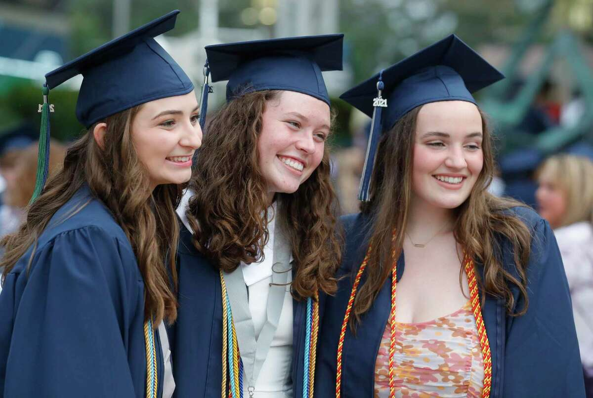 College Park students Sydney Rodgers, Riley Horne and Caroline Hammond pose for a photo before a graduation ceremony at Cynthia Woods Mitchell Pavilion, Monday, May 24, 2021, in The Woodlands.