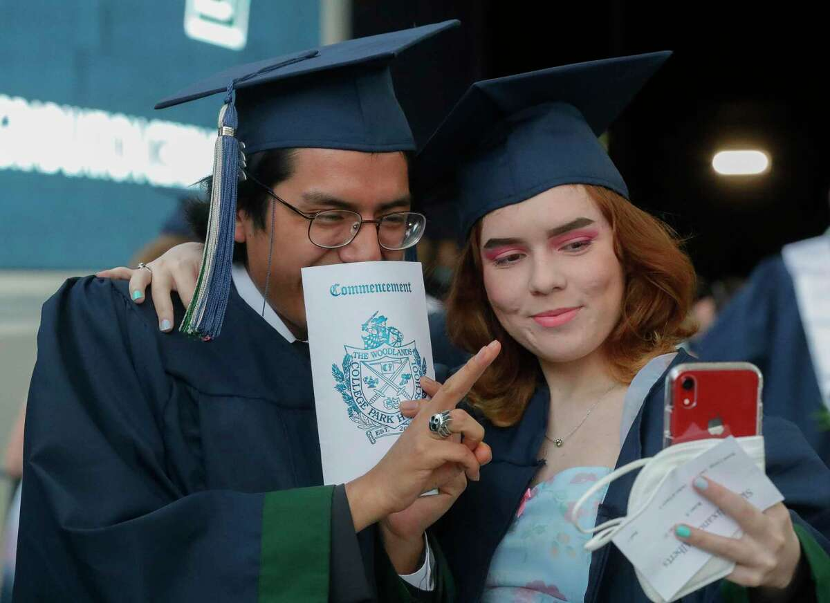 College Park students Carlos Lopez and Skye Alberta pose for a photo before a graduation ceremony at Cynthia Woods Mitchell Pavilion, Monday, May 24, 2021, in The Woodlands.