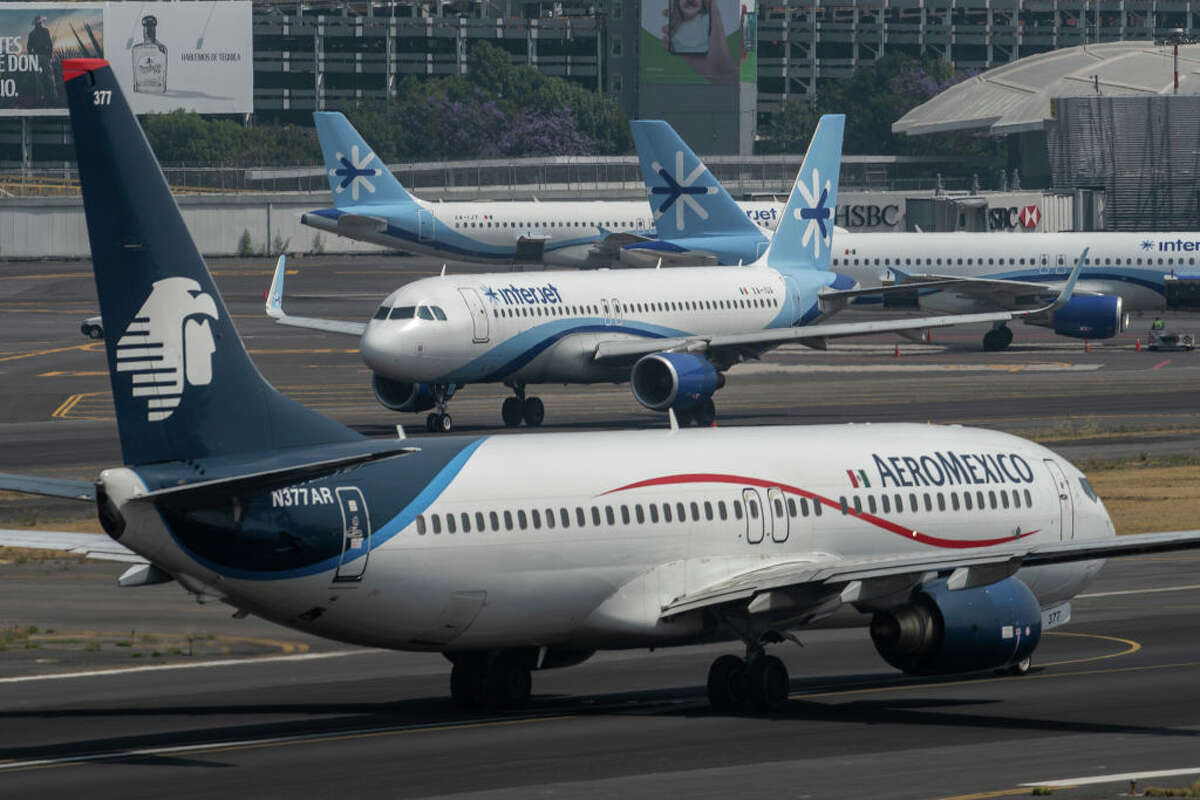 Interjet and Aeromexico planes prepare to take off on March 20, 2020. International flights kept operating in Mexico during the COVID-19 pandemic, unlike most other countries.