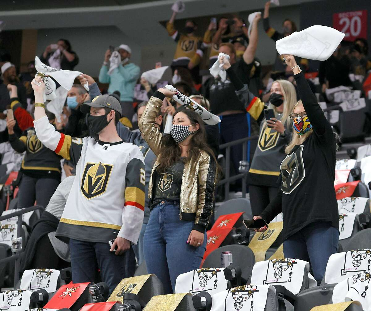 LAS VEGAS, NEVADA - MAY 24: Vegas Golden Knights fans wave towels as they watch the team warm up before Game Five of the First Round of the 2021 Stanley Cup Playoffs against the Minnesota Wild at T-Mobile Arena on May 24, 2021 in Las Vegas, Nevada. (Photo by Ethan Miller/Getty Images)