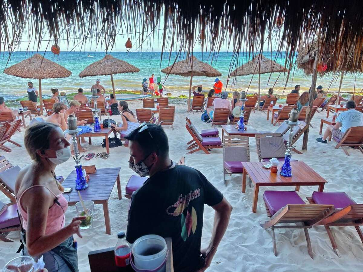 Tourists enjoy a beach restaurant in Playa del Carmen, Quintana Roo state, Mexico, on March 3, 2021, amid the coronavirus pandemic.