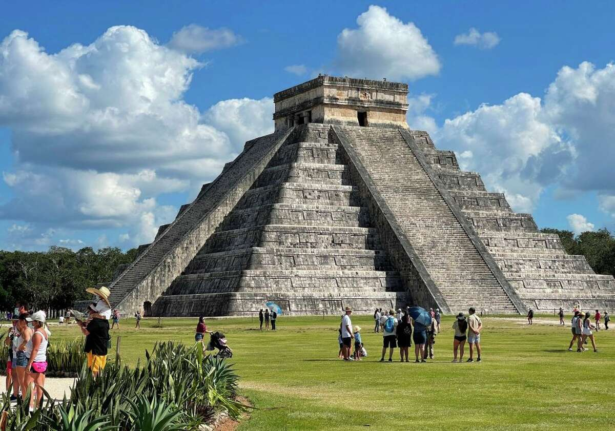 Tourists wearing face masks are seen at Chichen Itza archaeological site in Mexico on March 5, 2021.