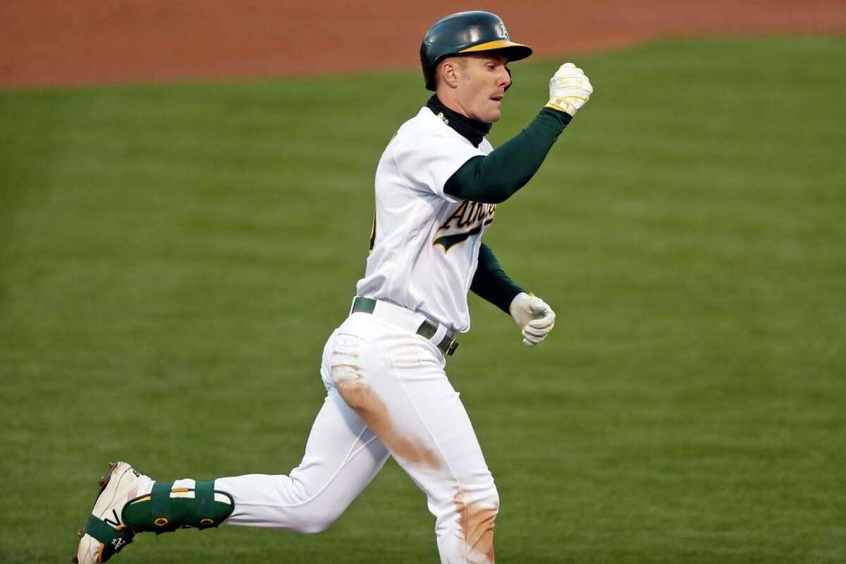 Oakland Athletics' Mark Canha rounds the bases after his solo home run against Seattle Mariners in 3rd inning of MLB game at Oakland Coliseum in Oakland, Calif., on Monday, May 24, 2021.