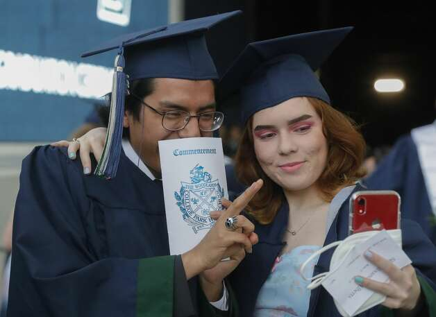 College Park students Carlos Lopez and Skye Alberta pose for a photo before a graduation ceremony at Cynthia Woods Mitchell Pavilion, Monday, May 24, 2021, in The Woodlands. Photo: Jason Fochtman/Staff Photographer / 2021 © Houston Chronicle