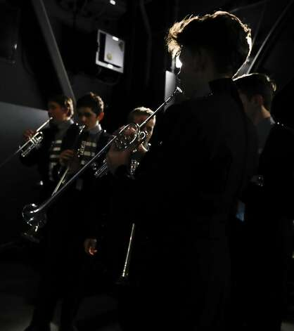 College Park student Alex Bass-Hill warms up his trumpet before a graduation ceremony at Cynthia Woods Mitchell Pavilion, Monday, May 24, 2021, in The Woodlands. Photo: Jason Fochtman/Staff Photographer / 2021 © Houston Chronicle